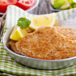 Pork schnitzel with parmesan — Stock Photo #48936049