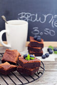 Stacked brownies with a cup of tea — Stock Photo