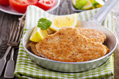 Pork schnitzel with parmesan — Stock Photo