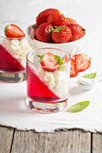 Dessert with strawberries and whipped cream — Stock Photo