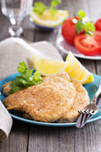 Pork schnitzel with parmesan — Stockfoto