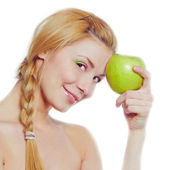 Smiling business woman with green apple — Stock Photo
