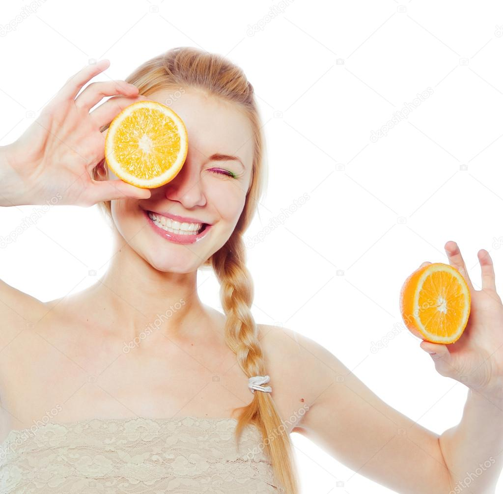 Young woman with oranges in her hands  — Stock Photo #12781755