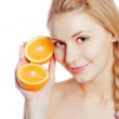 Young woman with oranges — Stock Photo