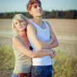 Stock Photo: Image of young man and woman on wheat field