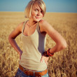 Image of young woman on wheat field — Stock Photo