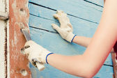 Portrait of smiling young woman making cosmetic alterations of house — Foto de Stock