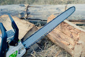 Close up chain saw on log — Stock Photo