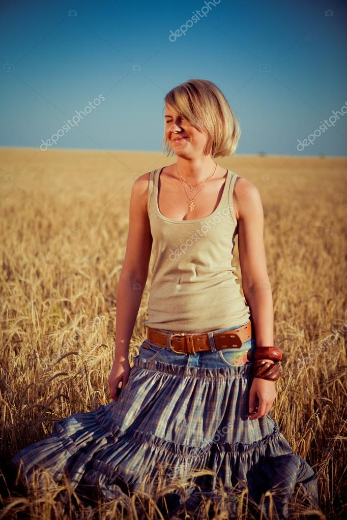 Image of young woman on wheat field  — Stock Photo #12876726