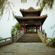 Chinese bridge over the Summer Palace lake. - Stock Photo