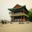 Traditional chinese garden with pond - Stock Photo
