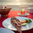 Roasted fish on a plate in restaurant — Stockfoto