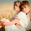Royalty-Free Stock Photo: Image of young man and woman on wheat field