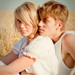 Image of young man and woman on wheat field — ストック写真
