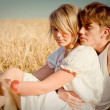 Image of young man and woman on wheat field — Stock fotografie