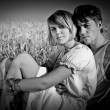 Image of young man and woman on wheat field — Stok fotoğraf