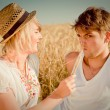 Image of young man and woman on wheat field — Stock Photo