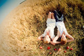 Image of young man and woman on wheat field — 图库照片