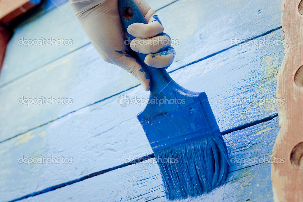 Hand painting blue wooden wall — Stock Photo #18652129