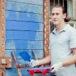 Man painting a house — Stock Photo #19166961
