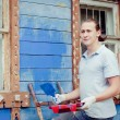 Man painting a house — Stock Photo #19166971