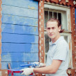 Man painting a house — Stock Photo #19166975