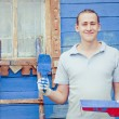 Man standing with tools for painting — Stock Photo