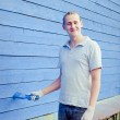 Painting house with brush — Stock Photo