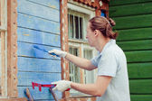 Man painting a house — Stock Photo