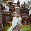Vertical photo of old beautiful stone Balinese statue in Besakih temple in Bali - Stock Photo