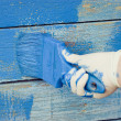 Royalty-Free Stock Photo: Hand painting blue wooden wall