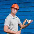 Man with axe on blue wooden background — Stok fotoğraf