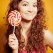Royalty-Free Stock Photo: Happy young woman with lollipop