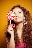 Happy young woman with lollipop — Foto de Stock