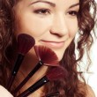 Young beautiful woman with make up tools — Stock Photo