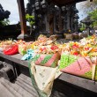 Offerings to gods in Bali with flowers, food and aroma sticks  — Stock Photo