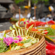 Offerings to gods in Bali with flowers, food and aromsticks — Stock Photo #27289497