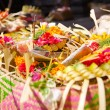 Offerings to gods in Bali with flowers, food and aroma sticks — Стоковая фотография