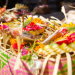Offerings to gods in Bali with flowers, food and aroma sticks — Stockfoto