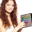 Beautiful girl  with multicolor eyeshadow palette — Stock Photo