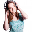Girl With Headphones Singing On White Background  — Foto Stock