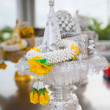 Flowers garland offering in buddhist temple. — Stock Photo