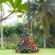 Christmas Tree On Beautiful Tropical Background — Stock Photo #37393565