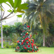 Christmas Tree On Beautiful Tropical Background — Stock Photo