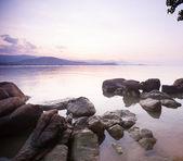 Tropical sunset on the beach — Stock Photo
