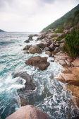 Waves crashing on rocks at coast — Stock Photo