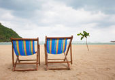 Beach chairs at sea front — Stock Photo