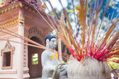 Offerings to gods in temple with aroma sticks — Stock Photo