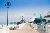 Lighthouse at the sea pier  — Stock Photo