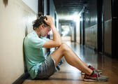 Young man  worried sitting on the floor — Stock Photo